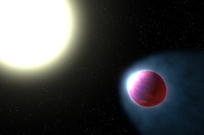 Огромна екзопланета със светеща атмосфера