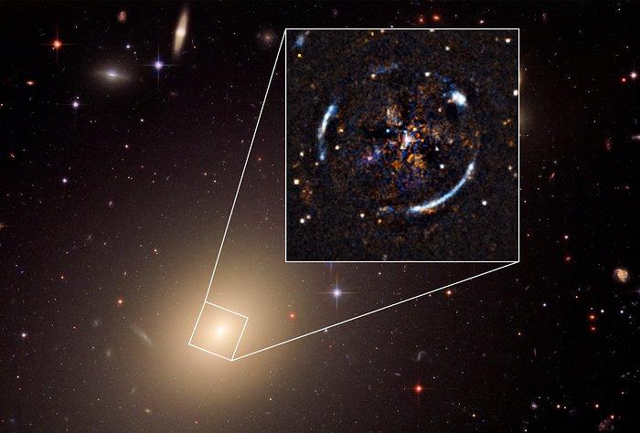 Снимка на гравитационната леща на галактика ESO325-G004, направена от телескопа Хъбъл на НАСА и MUSE instrument on the ESO' Very Large Telescope.  Credit: ESO, ESA/Hubble, NASA